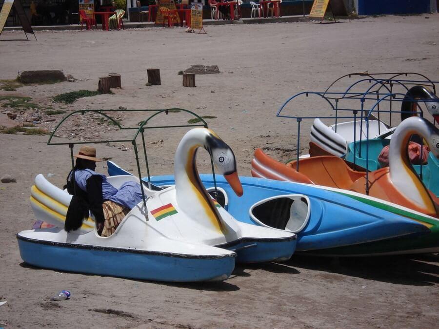 Bolivian woman sleeping in tourist boat