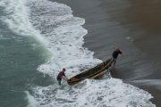 Fishermen pulling boat