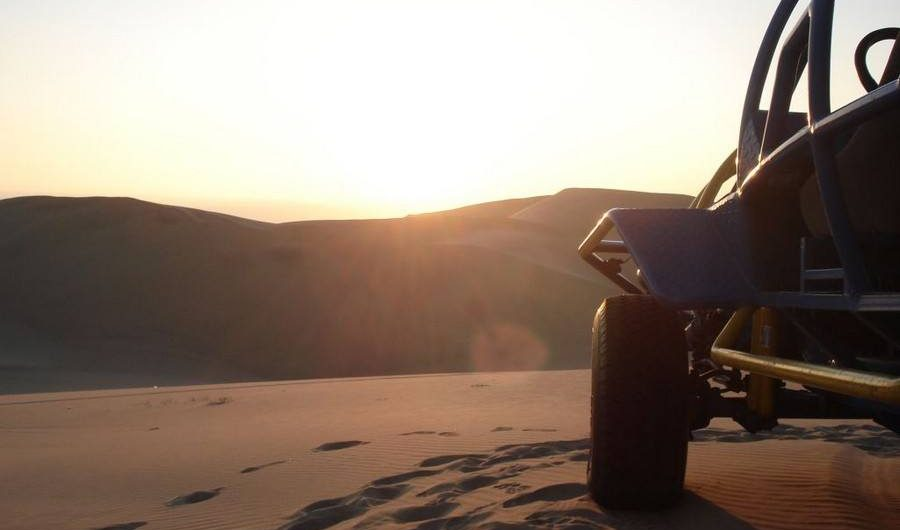 Sunset sandboarding, buggy tour