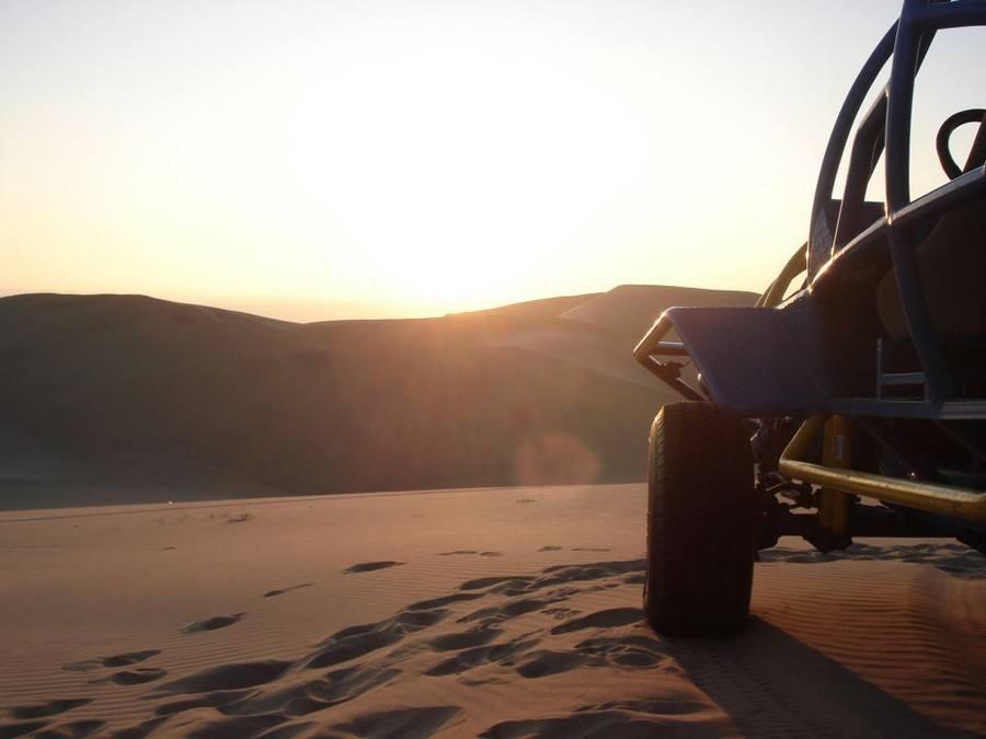 Sunset sandboarding, buggy tour